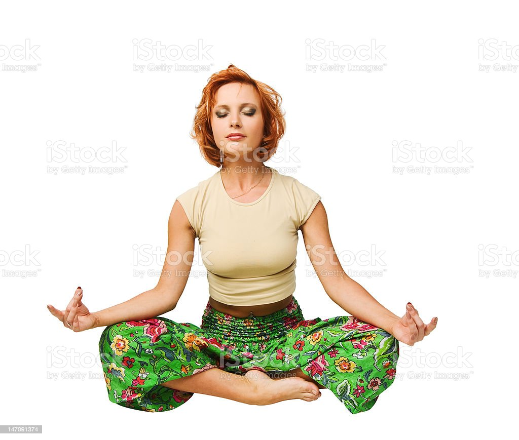 Red-haired girl meditating in lotus position royalty-free stock photo