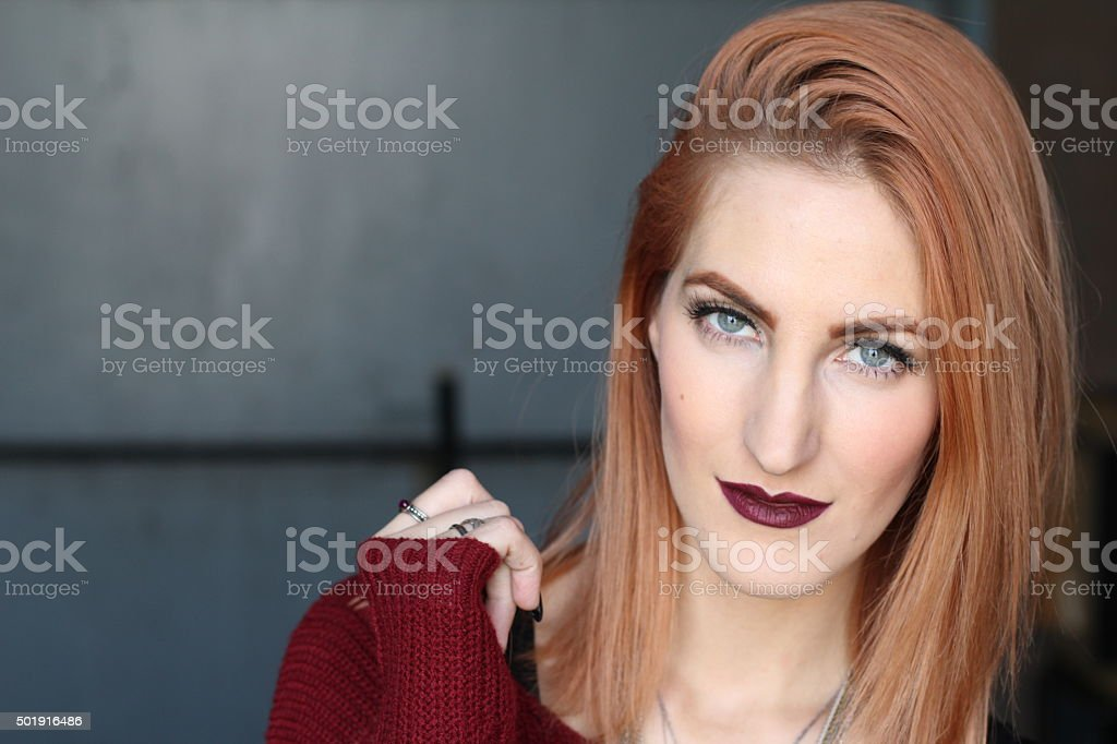 Red-haired girl with intense blue eyes and alternative look stock photo