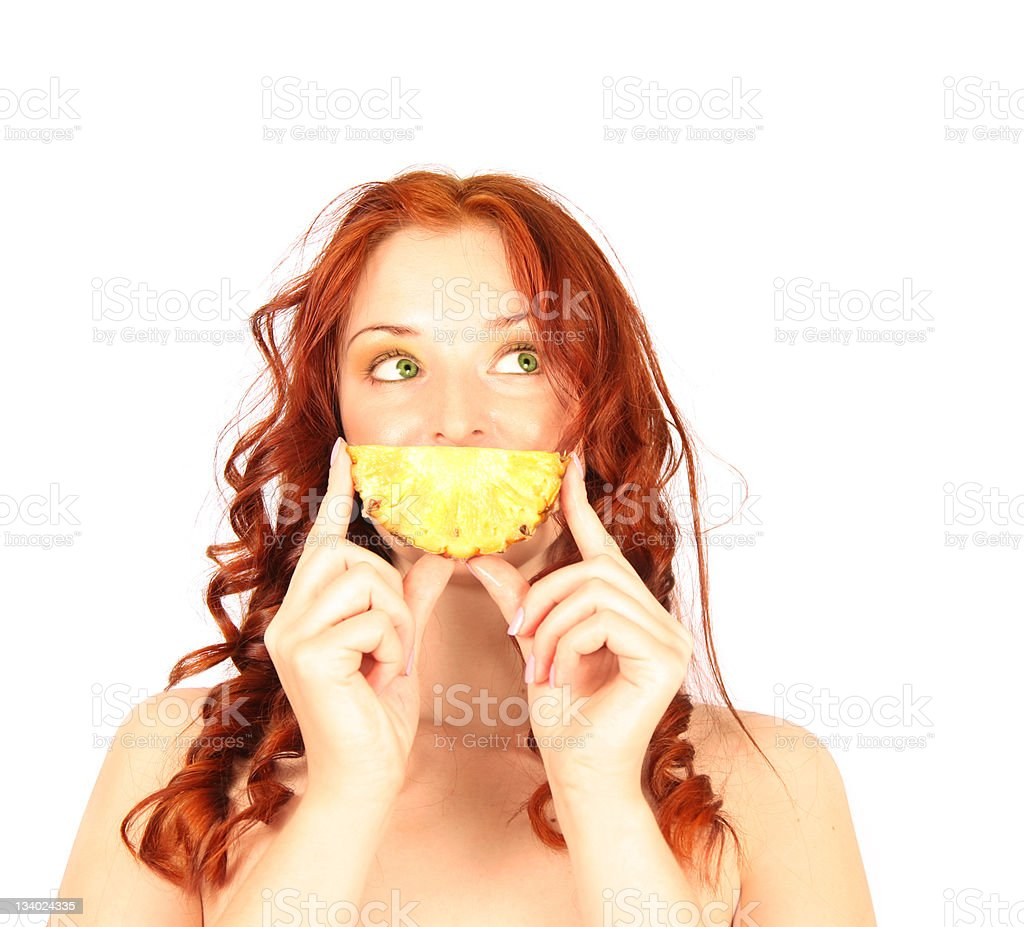 red-haired girl with pineapple isolated on white royalty-free stock photo