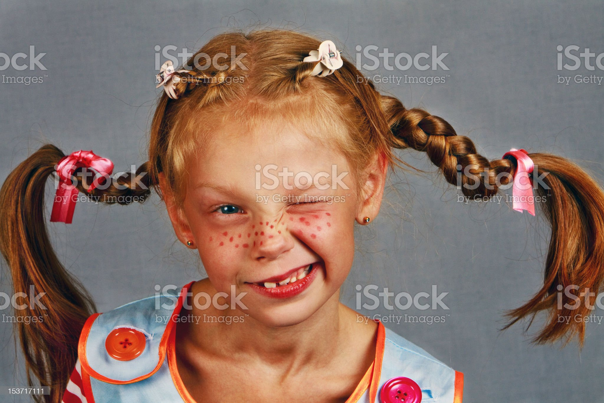Red-Haired Girl with Upward Braids are winks Making  Face royalty-free stock photo