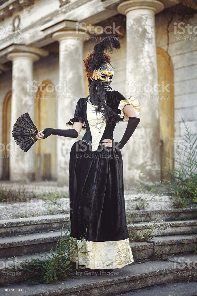 Red-haired lady in mask royalty-free stock photo