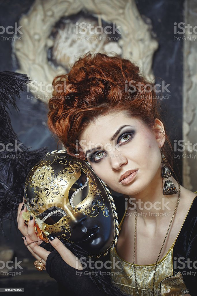 Red-haired lady in mask stock photo