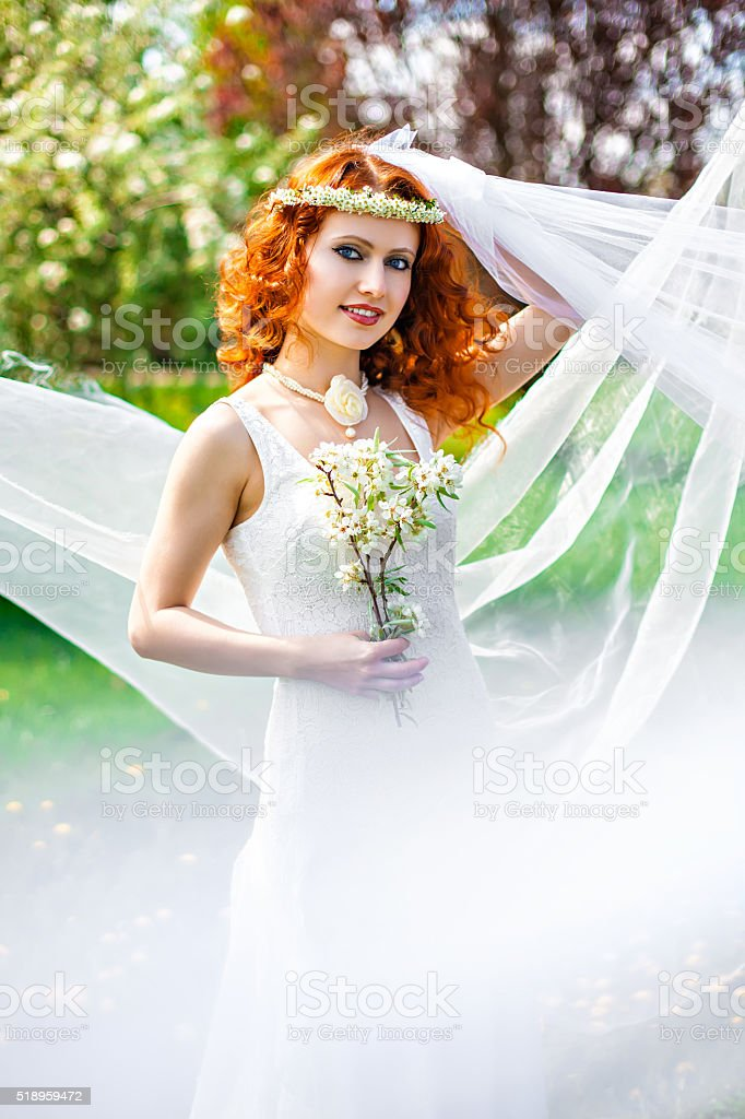 Red-haired spring beauty stock photo
