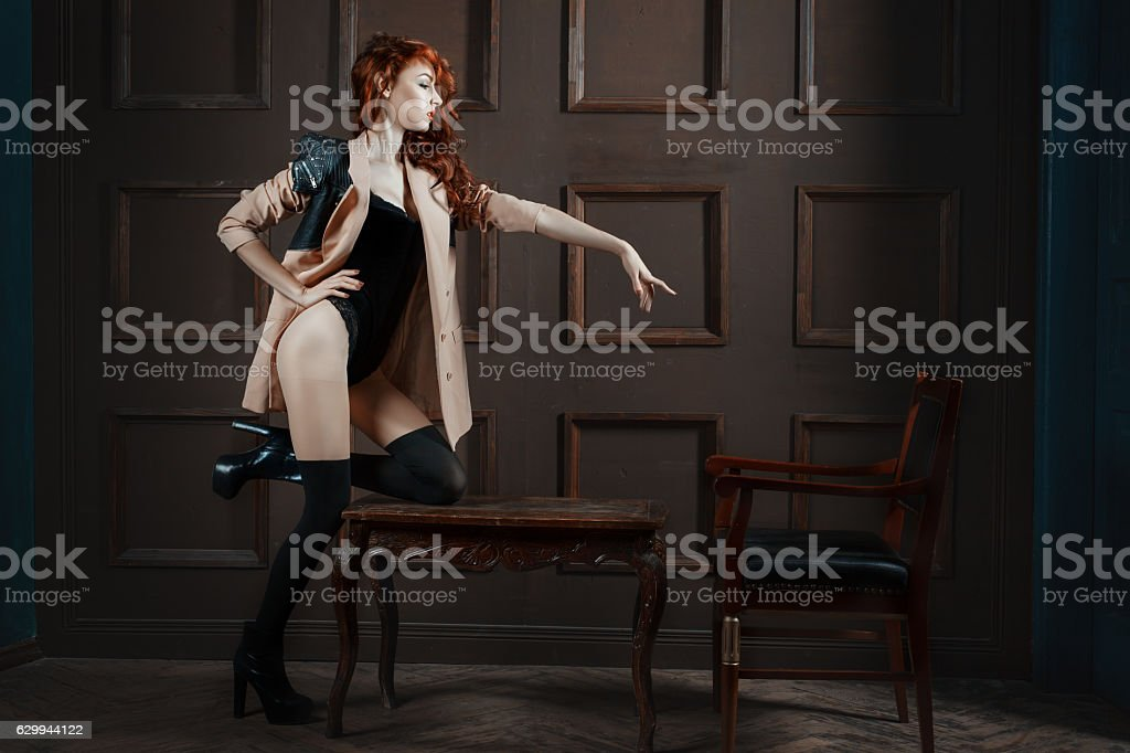 Red-haired woman pointing her finger. stock photo