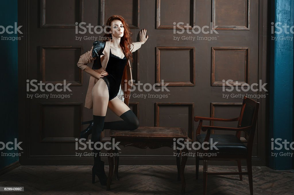 Red-haired woman with a beautiful figure. stock photo
