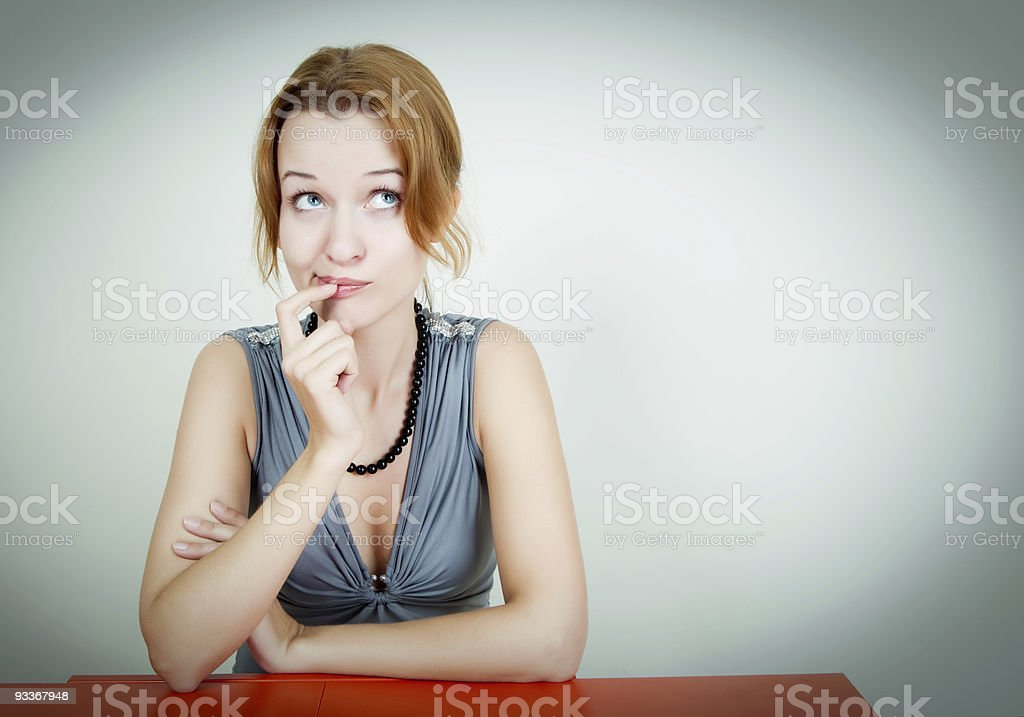Red-haired woman with blue eyes looking contemplative royalty-free stock photo