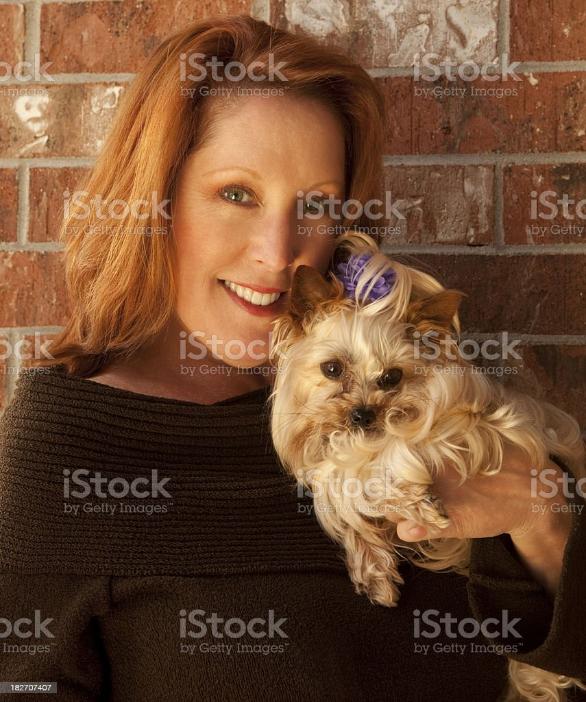 Red-haired Woman with Yorkshire Terrier stock photo