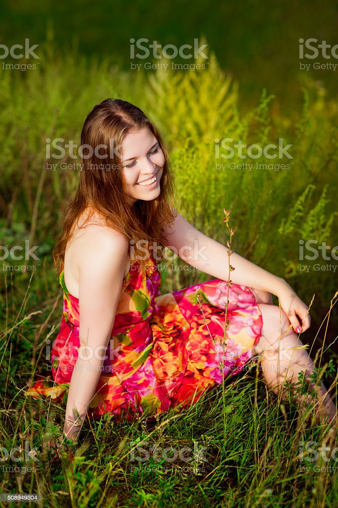 Red-haired young woman with long ginger hair and closed eyes stock photo