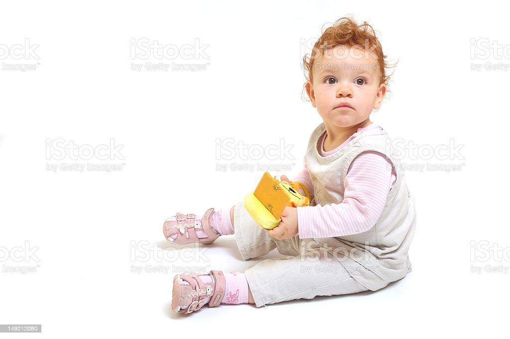 Redhead baby playing royalty-free stock photo