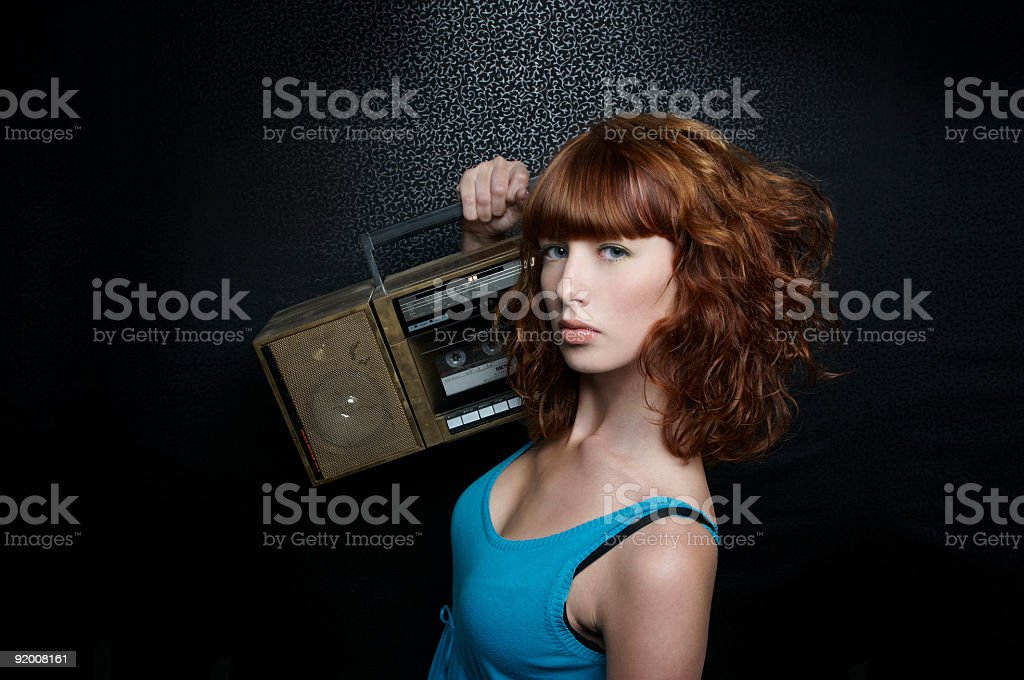 Redhead beauty with boombox royalty-free stock photo