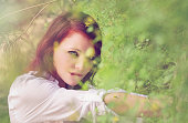 Redhead behind the bush