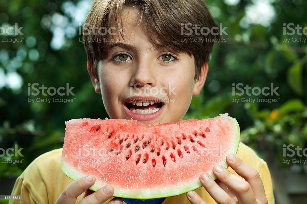 Redhead Boy Eating Watermelon royalty-free stock photo
