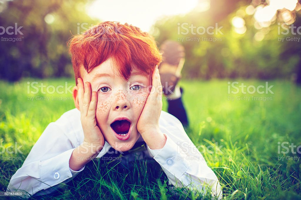 Redhead boy outdoors stock photo