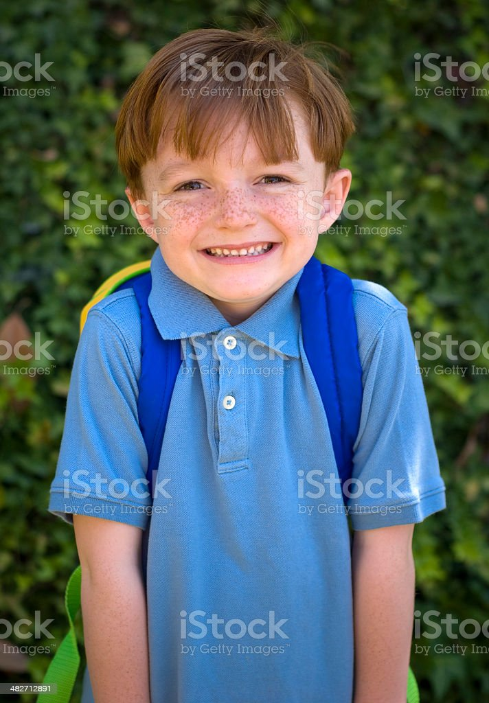 Redhead boy smiling on first day of school royalty-free stock photo