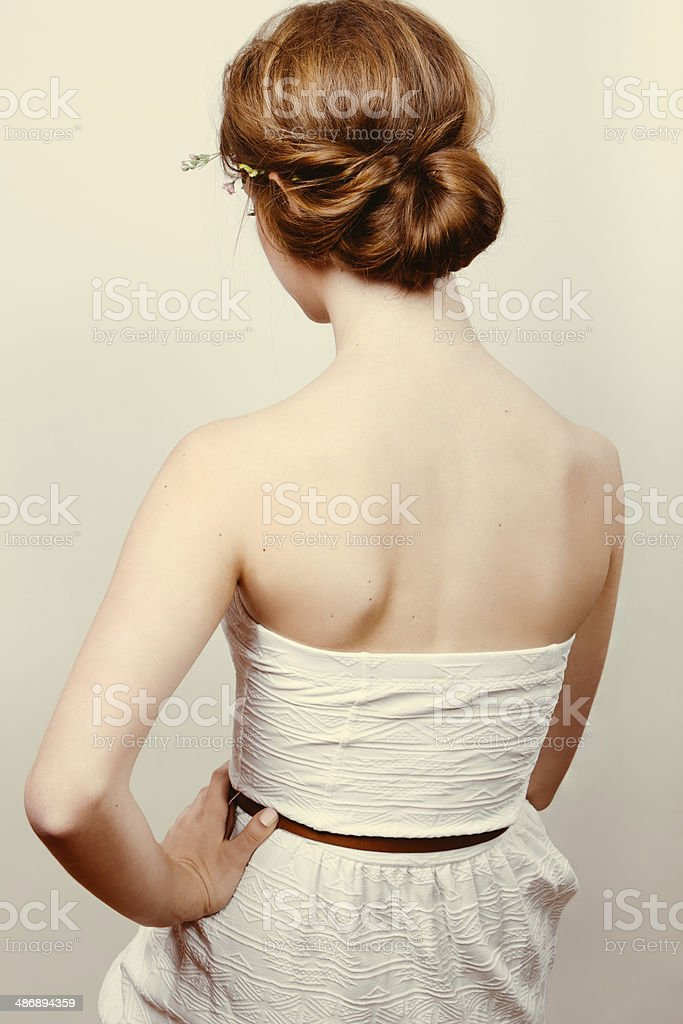 Redhead bride with romantic bun stock photo