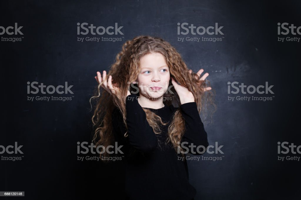 Redhead Child Girl. Cute Child with Long Red Hair stock photo