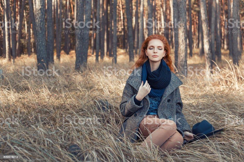 redhead girl relaxing stock photo