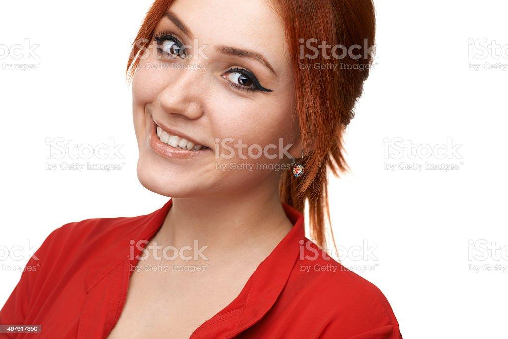 Redhead  girl smiles sweetly stock photo