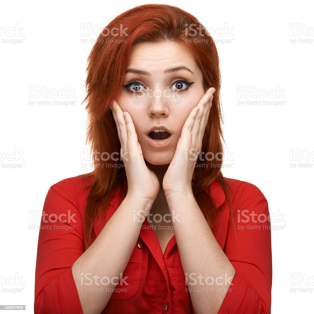 Redhead  girl unpleasantly surprised stock photo