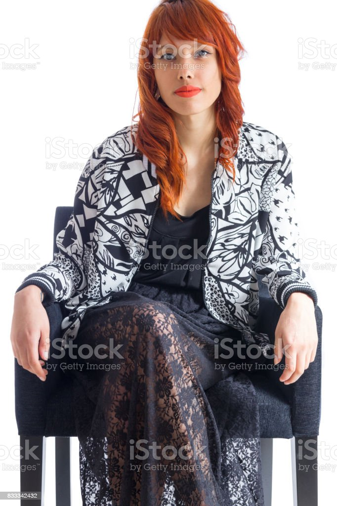 Redhead girl wears black and white jacket and wearing a black skirt. stock photo