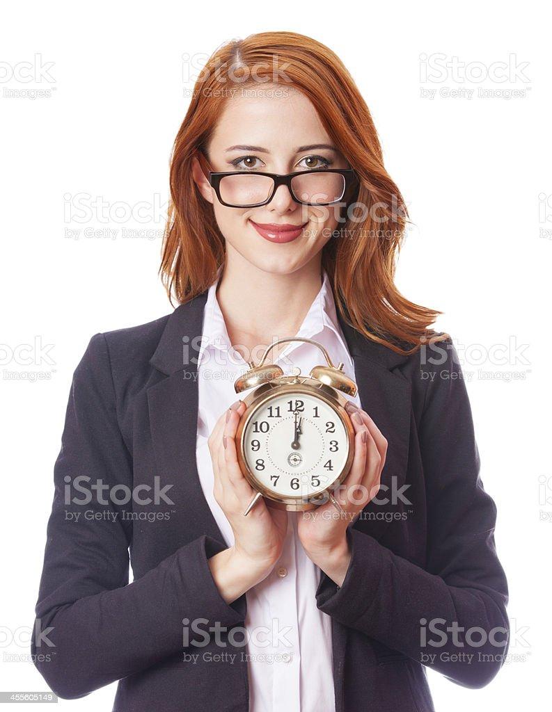 Redhead girl with clock stock photo