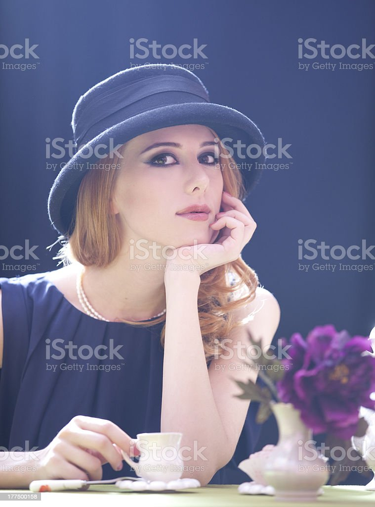 Redhead girl with cup at cafe. Photo in 90s style. royalty-free stock photo