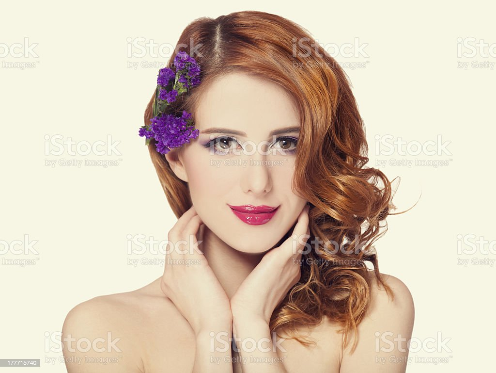 Redhead girl with flower, isolated. royalty-free stock photo