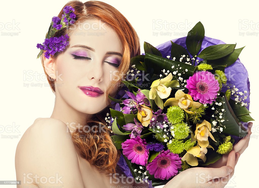 Redhead girl with flowers, isolated. royalty-free stock photo