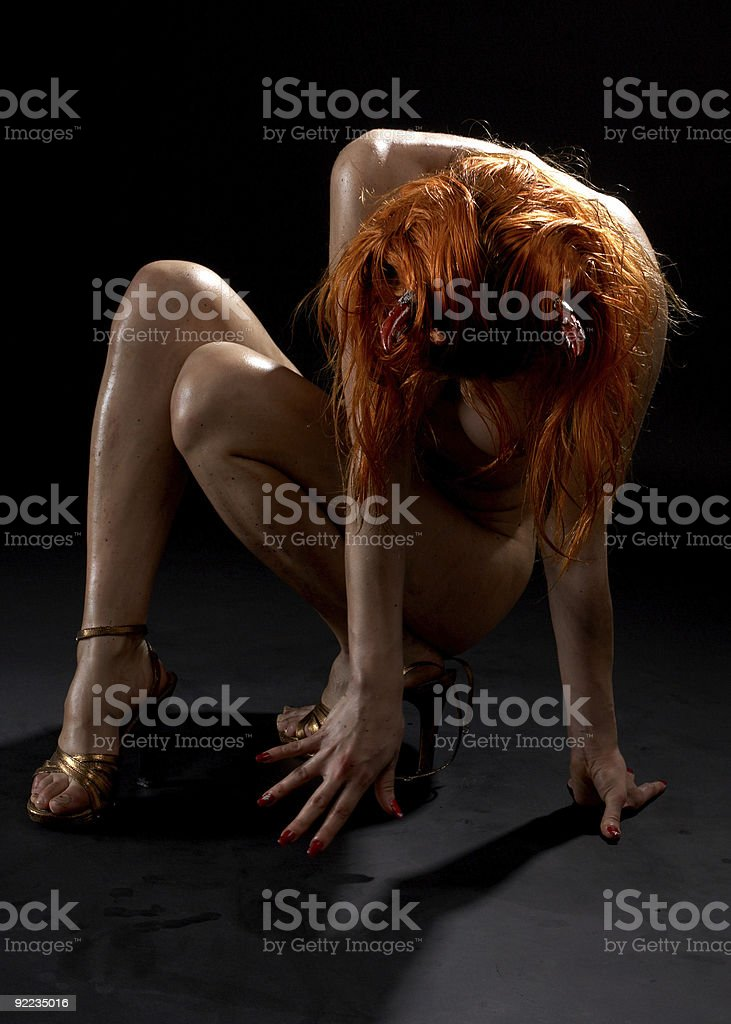redhead girl with horns on high heels royalty-free stock photo