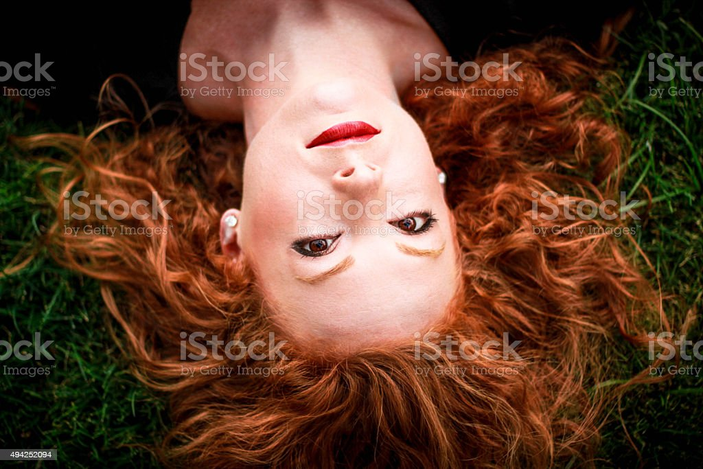 Redhead In Grass stock photo