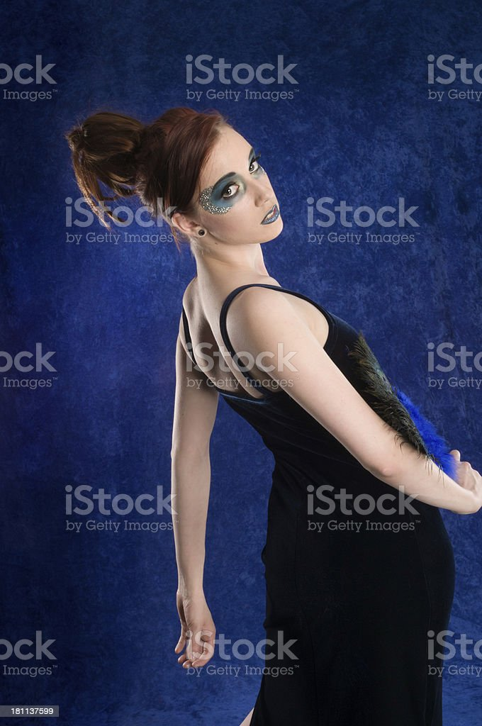 Redhead in velvet dress leaning back doing fashion pose royalty-free stock photo