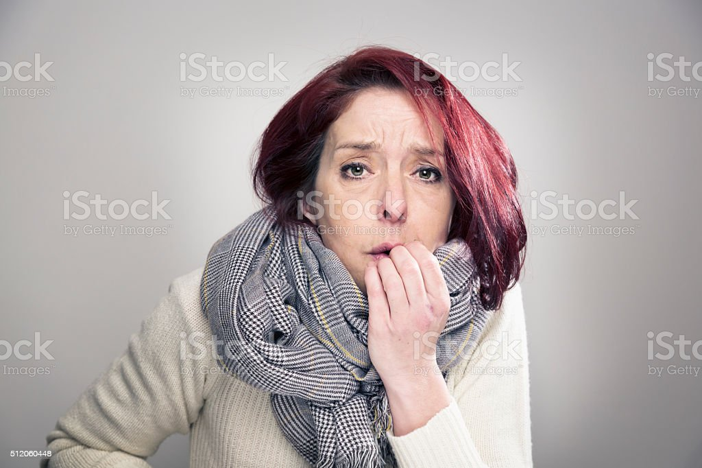 redhead midadult woman winter portrait stock photo