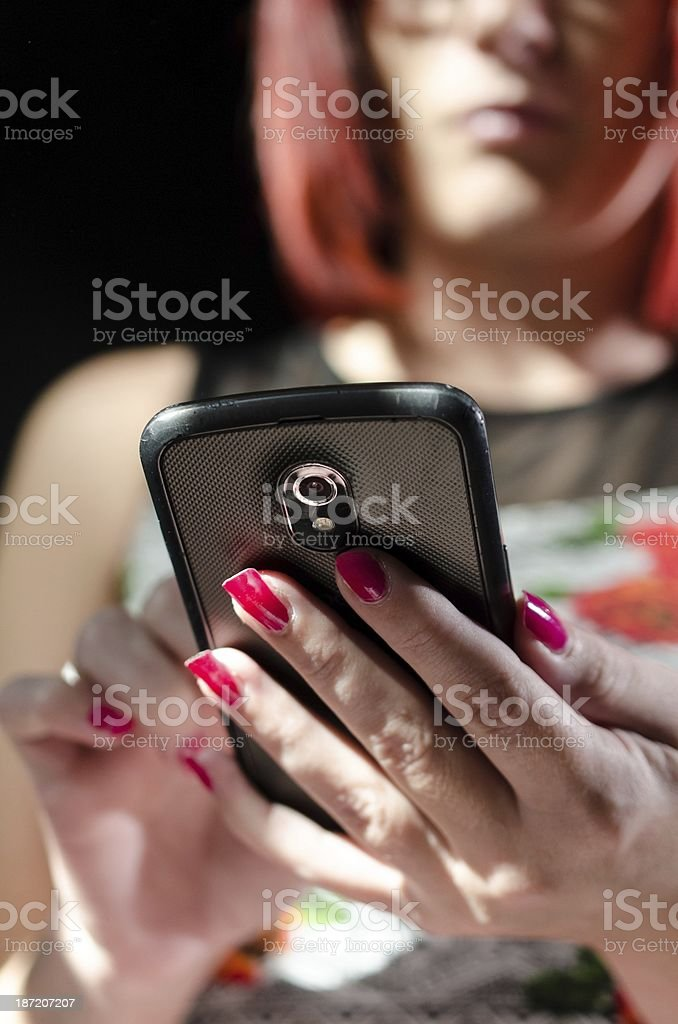 Redhead using cell phone royalty-free stock photo