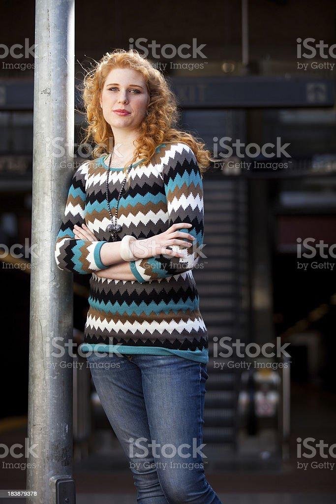 Redhead Waiting at Train Platform royalty-free stock photo