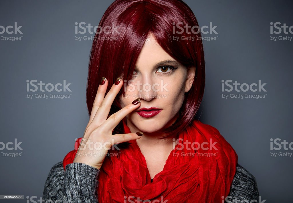 Redhead with Red Stick On Nail Art or Nail Polish stock photo