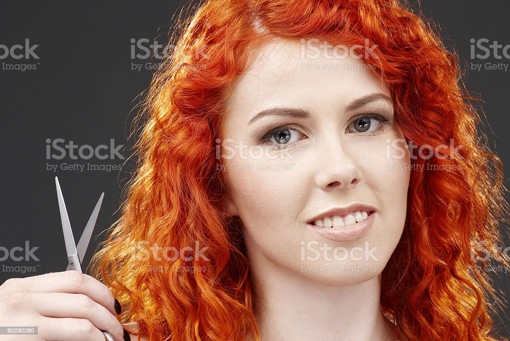 redhead with scissors #2 royalty-free stock photo