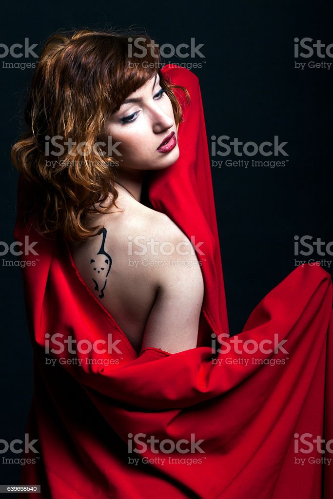 Redhead with tattoo stock photo