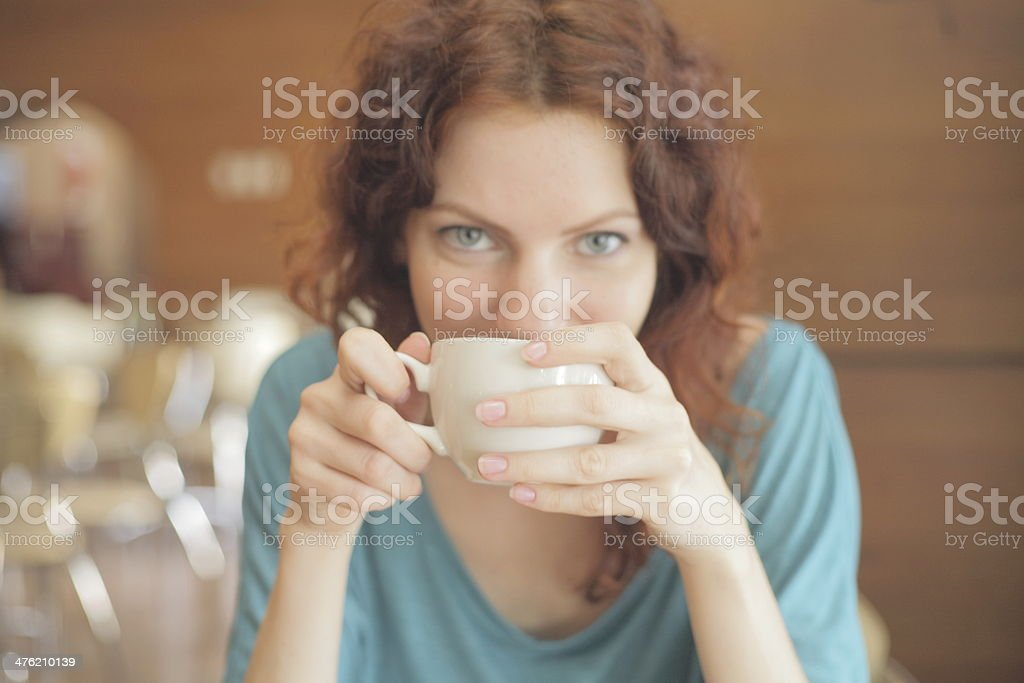 Redhead Woman Drinking Coffee royalty-free stock photo