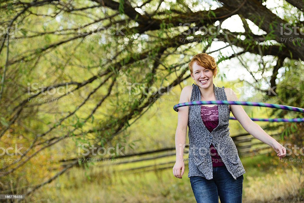 Red-Head Woman Playing With Hula Hoop royalty-free stock photo