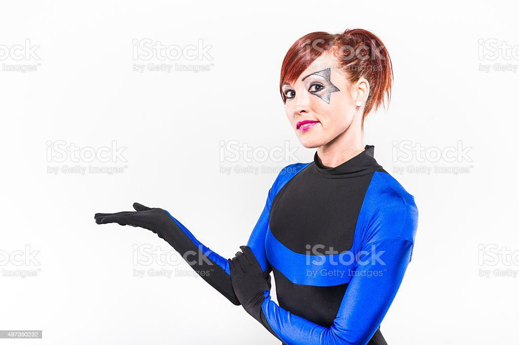 Redhead Woman Presenting In Costume stock photo
