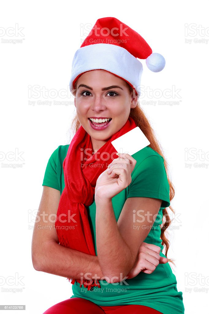 Redhead young woman holding and showing blank greeting card stock photo