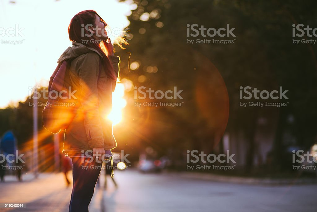 Redheaded Beauty in Sunset stock photo