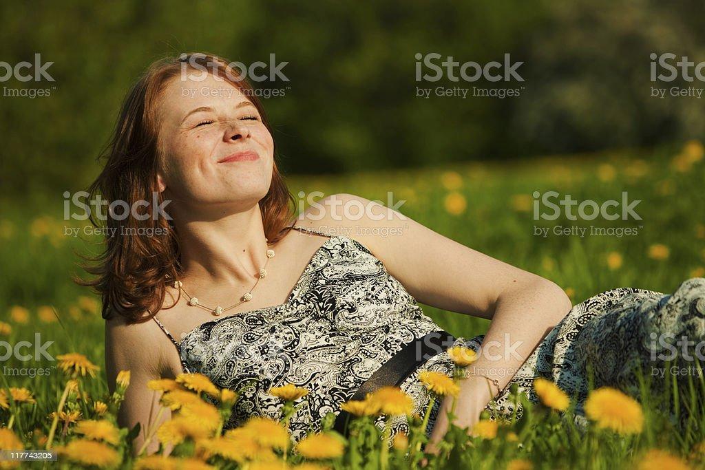 Redheaded girl enjoying sunbath royalty-free stock photo