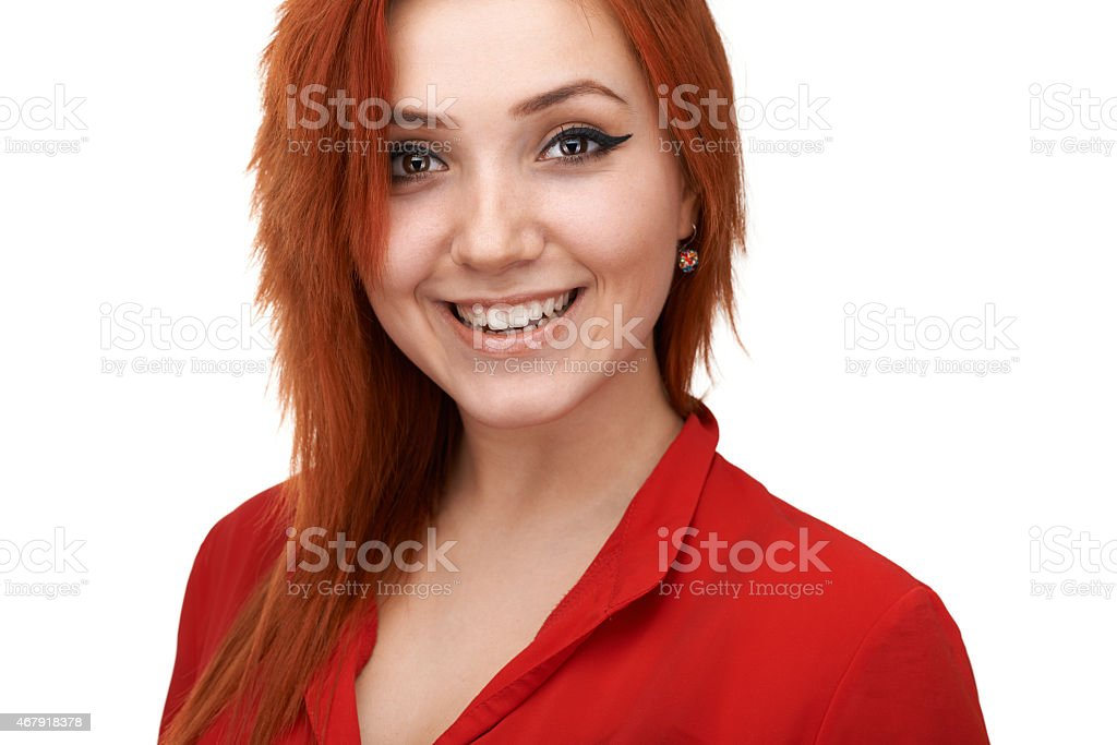 redheaded  girl smiling generously stock photo