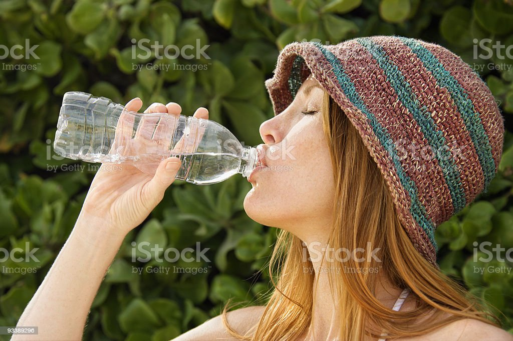 Redheaded woman drinking water. royalty-free stock photo