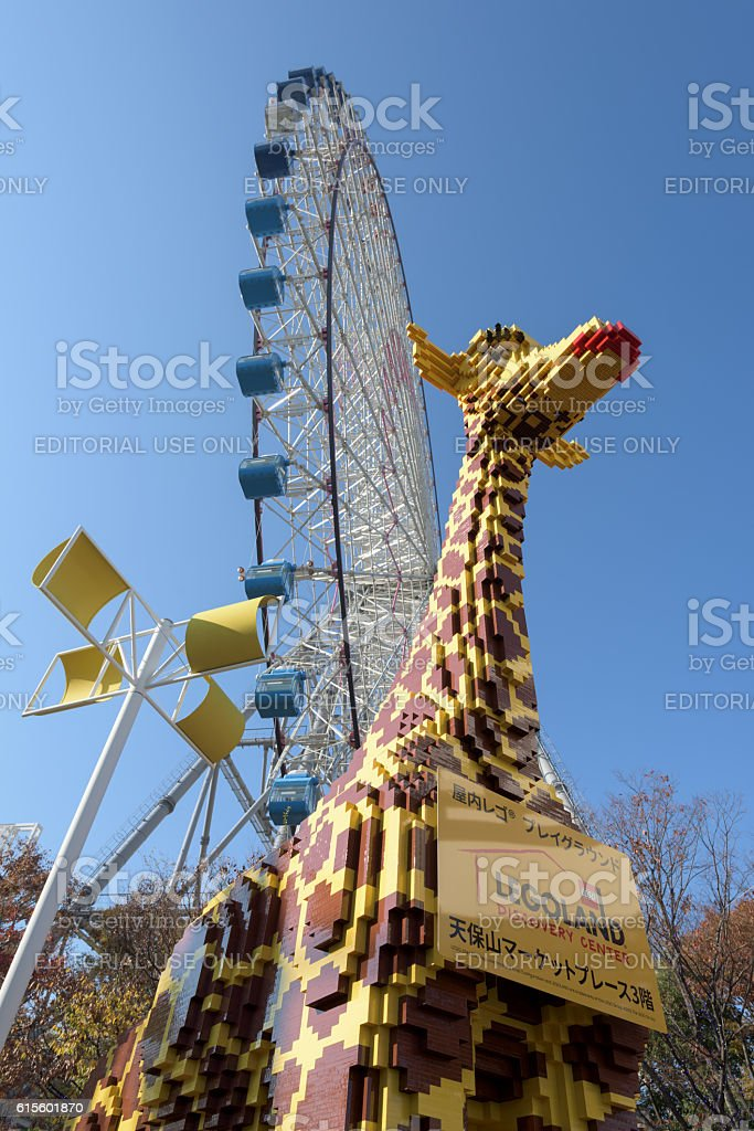 Redhorse Osaka Wheel and a Giant Lego Giraffe stock photo