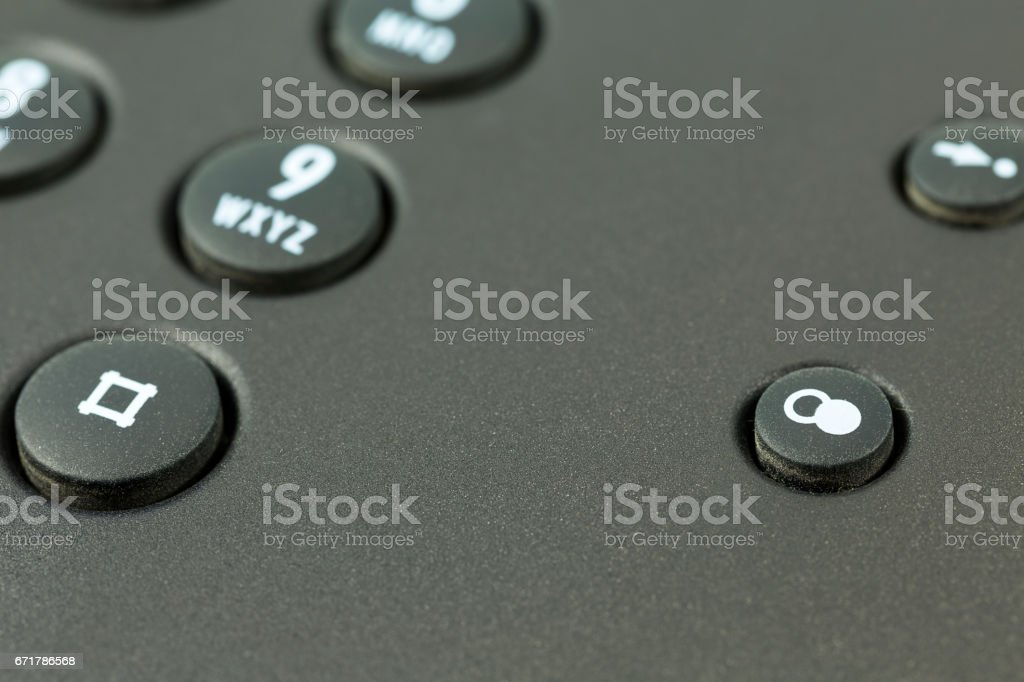 redial push button of a black telephone stock photo