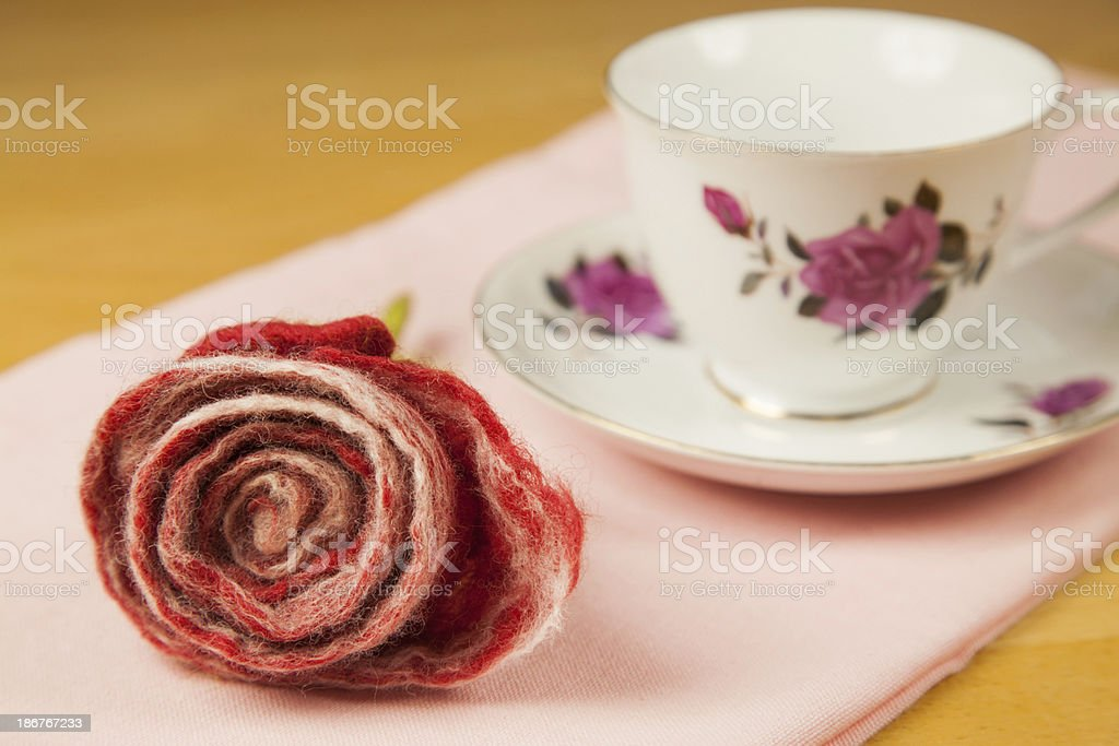 Redl felt rose and old porcelain cup royalty-free stock photo