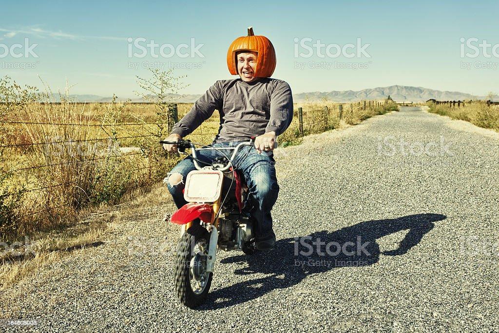 Redneck Pumpkin Motorcycle Racer stock photo