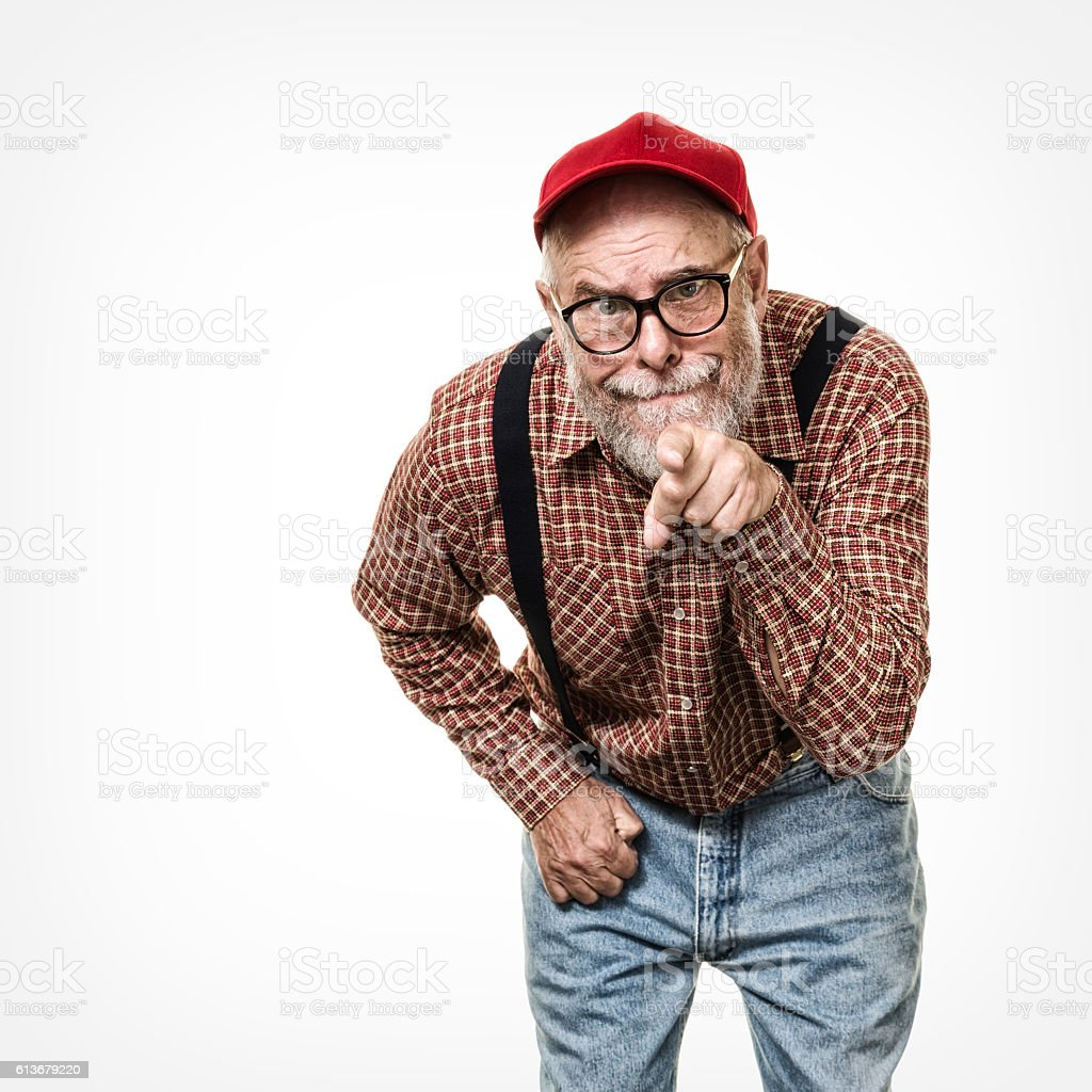 Redneck Red Hat Suspenders Hillbilly Senior Man Pointing and Accusing stock photo
